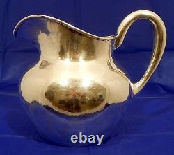 A hand wrought sterling water pitcher, The Kalo Shop, Chicago c. 1940