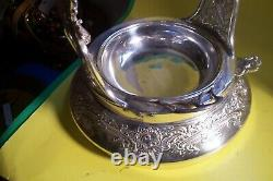 ANTIQUE ORNATE VICTORIAN S/P. MERIDEN 1870's TILTING WATER PITCHER ON STAND, L-F5
