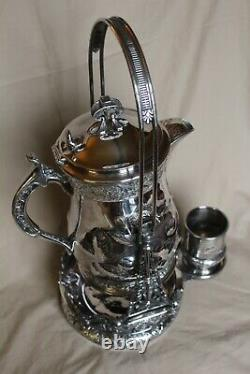 American Victorian SP Tilting Ice Water Pitcher On Frame -Wilcox Silver Plate Co