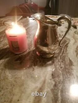 Antique sterling silver water pitcher