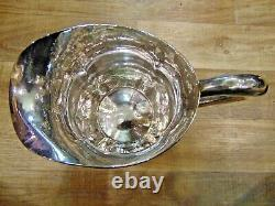 Sterling Silver Arts and Crafts Water Pitcher by Lewy Bros. Hand Hammered