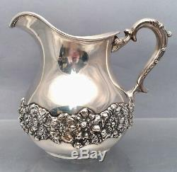 Sterling Water Pitcher With Floral Decoration by Hamilton & Diesinger