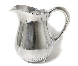 Sterling silver water pitcher (jug). Arts and Crafts. USA, Lewy Bros. Co