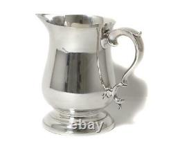Sterling silver water pitcher (jug). USA, workshop Poole Silver Company