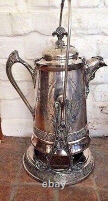 Victorian silver tilting water urn