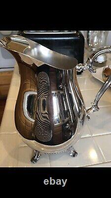 WM Rogers Silver plated water pitcher Footed Stand Vintage and ice guard 817