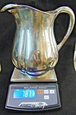 Sterling Silver Arts And Crafts Water Pitcher Par Lewy Bros.